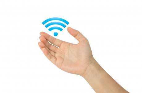 Hand with wi-fi icon